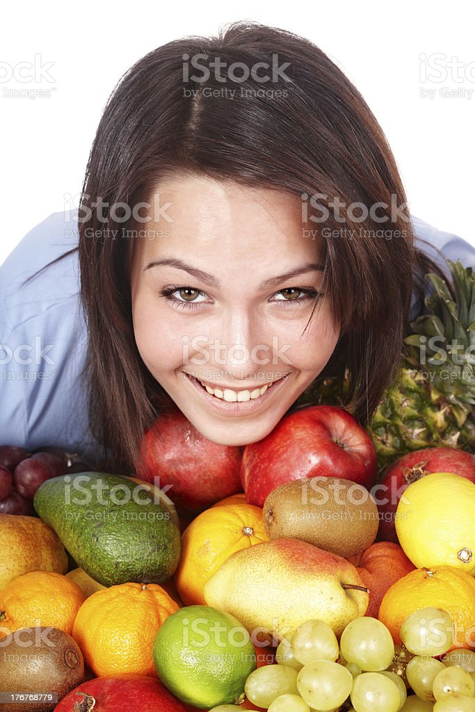 Happy girl with group of fruit. royalty-free stock photo