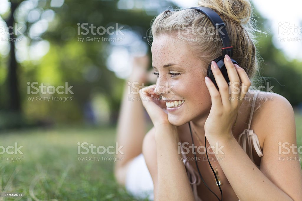 Happy girl with headphones royalty-free stock photo
