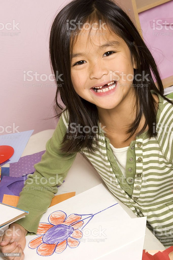 Happy girl with her artwork royalty-free stock photo