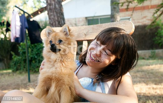 istock Happy girl with her little pomeranian 1172149207