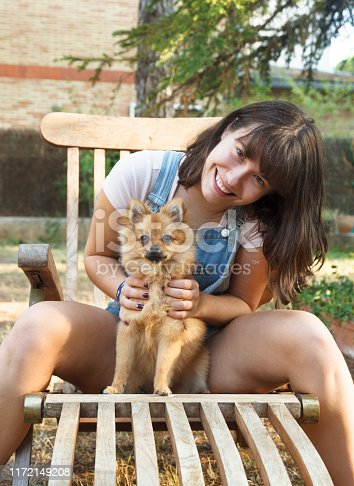 istock Happy girl with her little pomeranian 1172149208