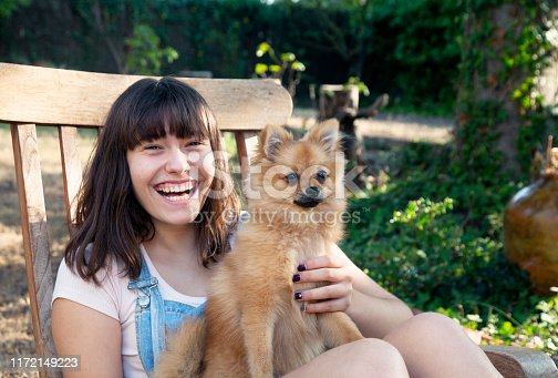 istock Happy girl with her little pomeranian 1172149223