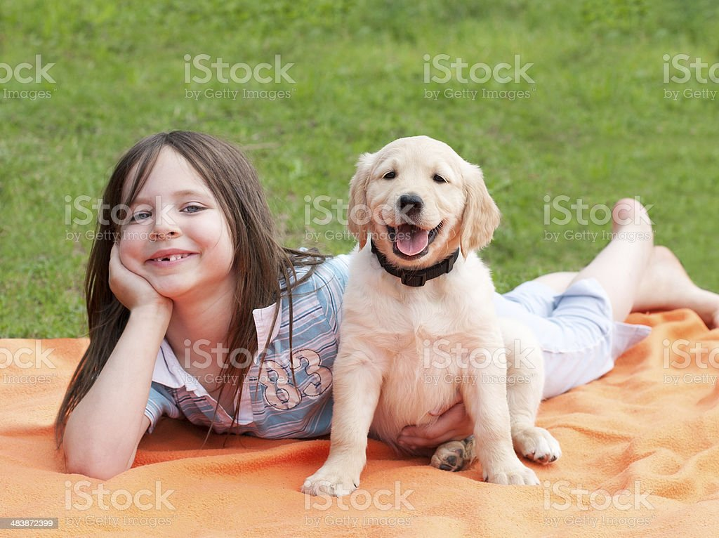 Happy girl with her puppy royalty-free stock photo