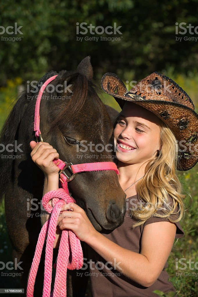 Happy Girl with Horse, Cowboy Hat and Pink Tack royalty-free stock photo