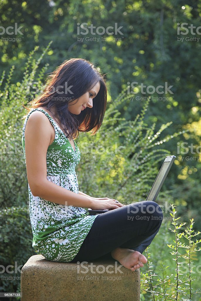 happy girl with laptop in the park royalty-free stock photo