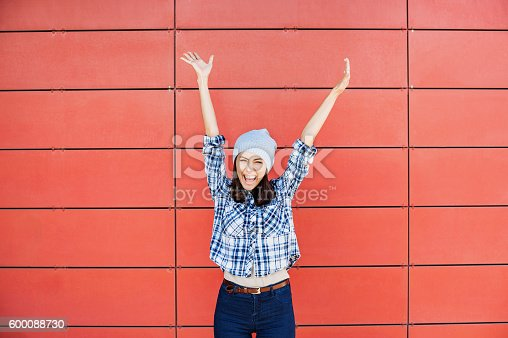 istock Happy girl with raised hands 600088730