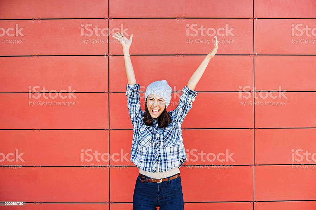 Happy girl with raised hands stock photo