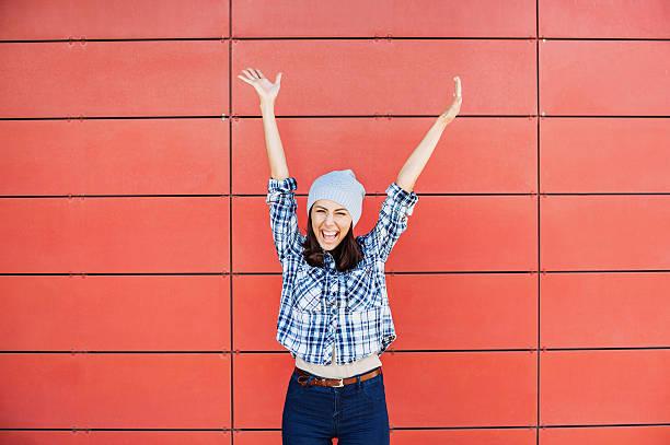 Happy girl with raised hands stock photo