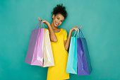 istock Happy girl with shopping bags 892728916