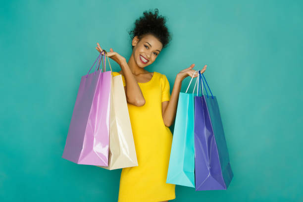 happy girl with shopping bags - excited emoji stock photos and pictures