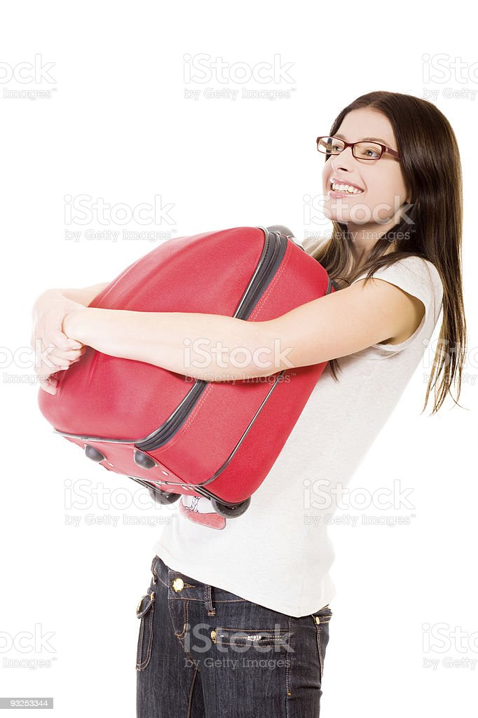 happy girl with suitcase on a white background royalty-free stock photo