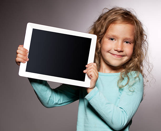 Happy girl with tablet computer stock photo