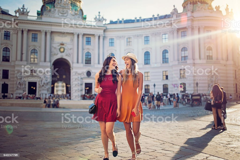 Happy girlfriends are walking and make fun together in the center of Vienna stock photo