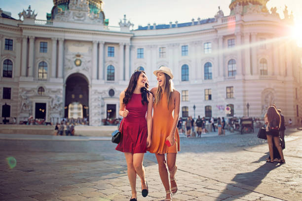 happy girlfriends are walking and make fun together in the center of vienna - vienna stock photos and pictures