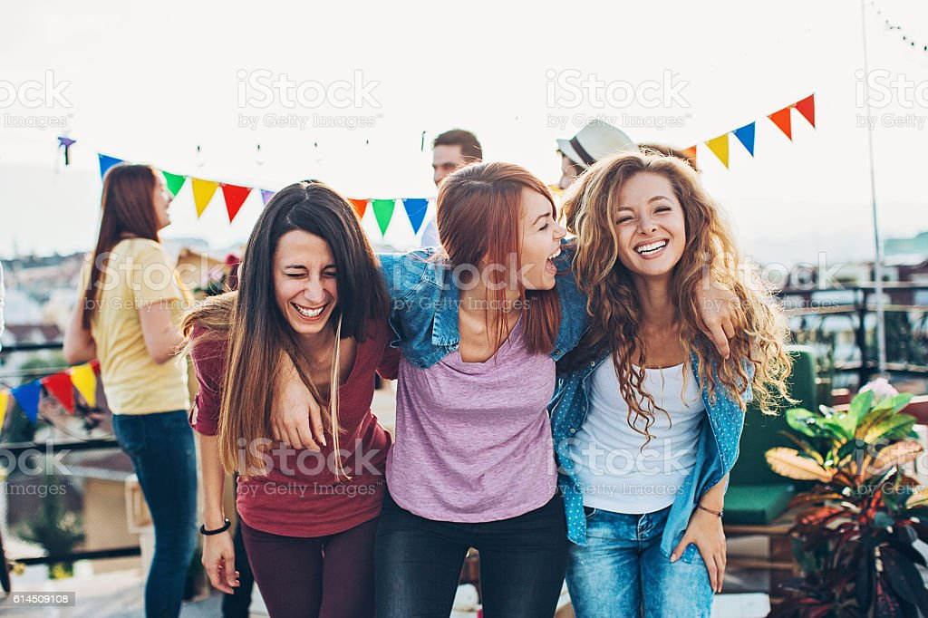 Happy girlfriends on a party stock photo