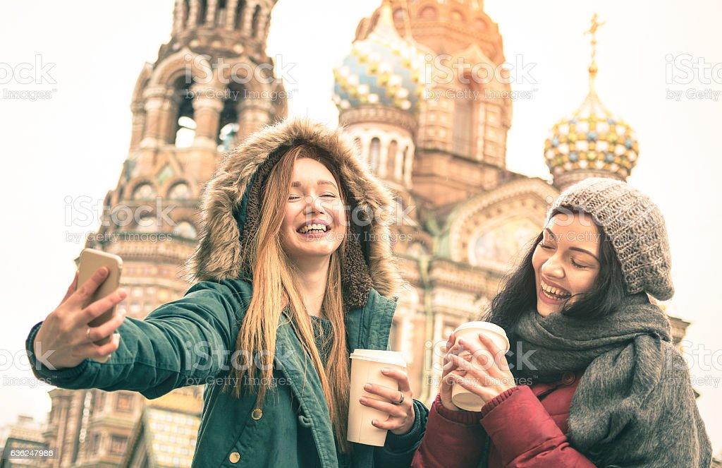 Happy girlfriends taking winter selfie in Saint Petersburg Russia stock photo
