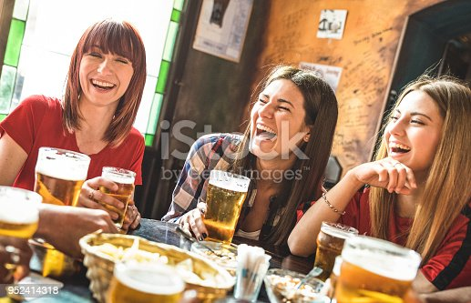 istock Happy girlfriends women group drinking beer at brewery bar restaurant - Friendship concept with young female friends enjoying time and having genuine fun at cool vintage pub - Focus on left girl 952414318
