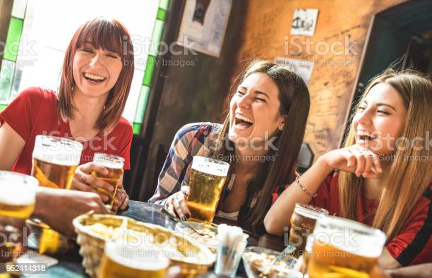 Happy girlfriends women group drinking beer at brewery bar restaurant picture id952414318?b=1&k=6&m=952414318&s=612x612&h=citph8uenyzlhnkzoz0ckttmdu2enjz4py9n vxpa7s=