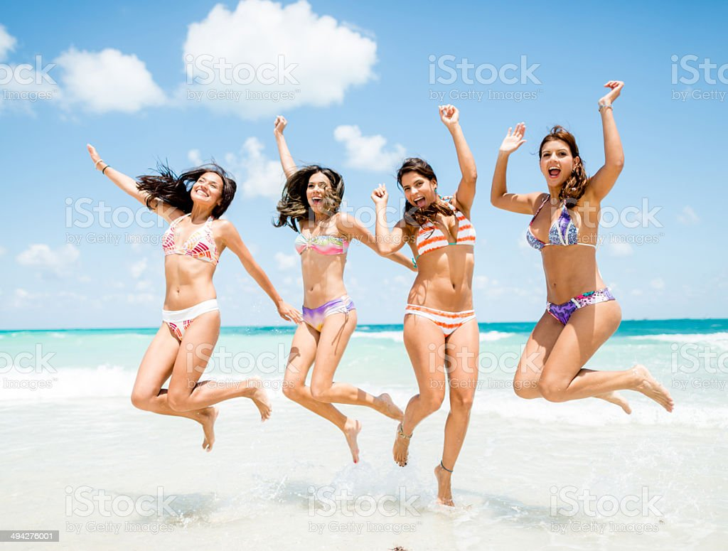 Happy girls at the beach stock photo