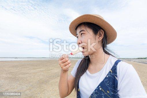 612518776 istock photo Happy girls enjoy ice cream and summer vacations 1220385404