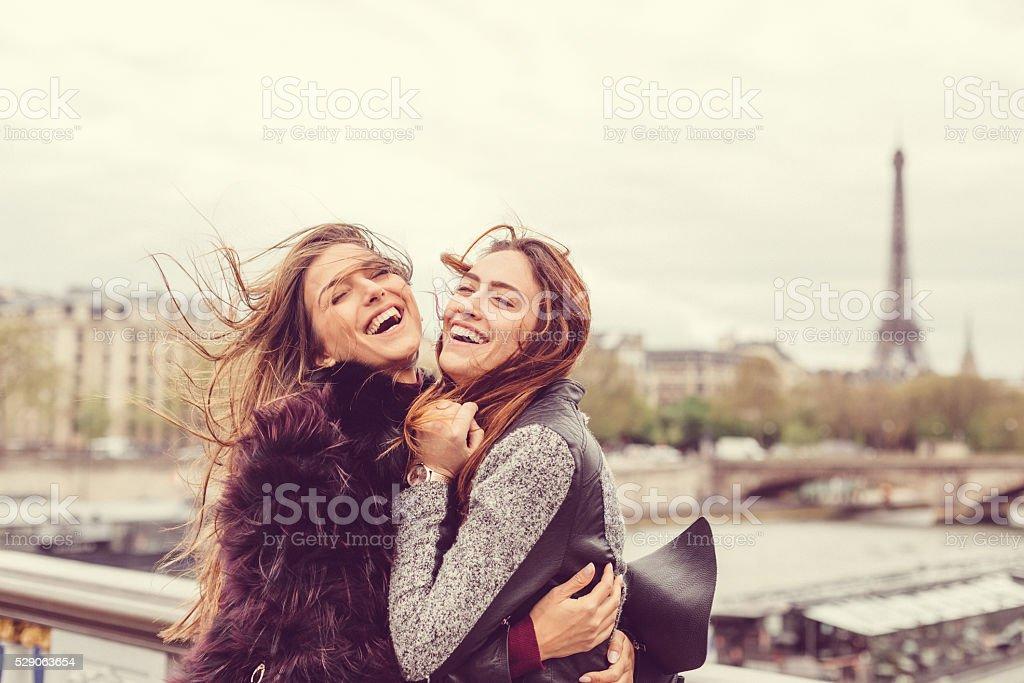 Happy girls enjoying Paris together stock photo