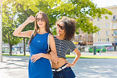istock Happy girls having fun while walking in the city 931672208