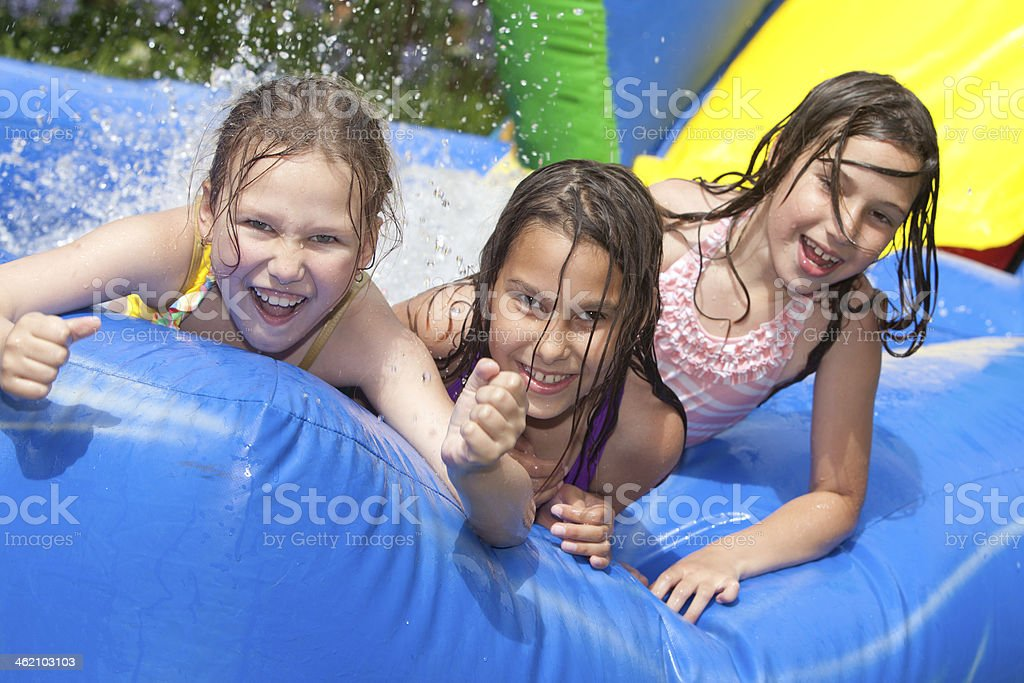 happy girls in inflatable swimming pool stock photo