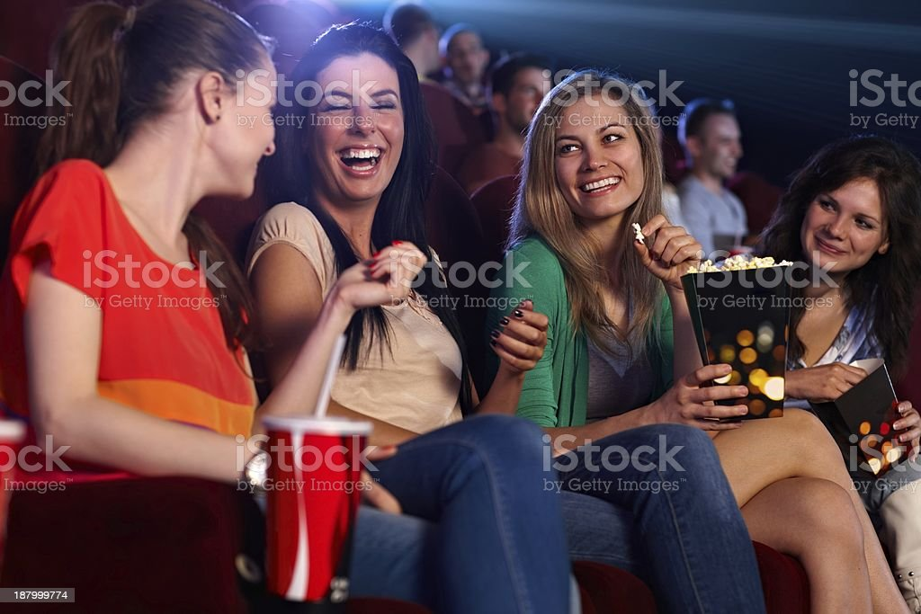Happy girls in multiplex movie theater stock photo