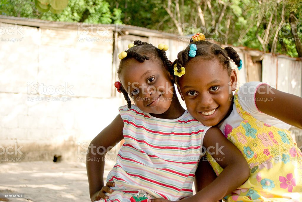 happy girls looking into camera and smiling stock photo