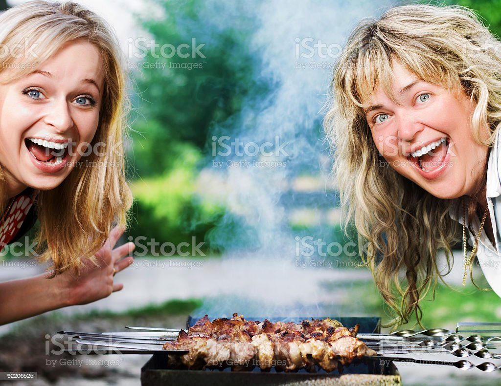 Happy Girls near the Grill royalty-free stock photo