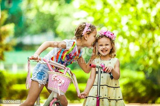 665192886 istock photo Happy Girls Riding Bikes 539099402