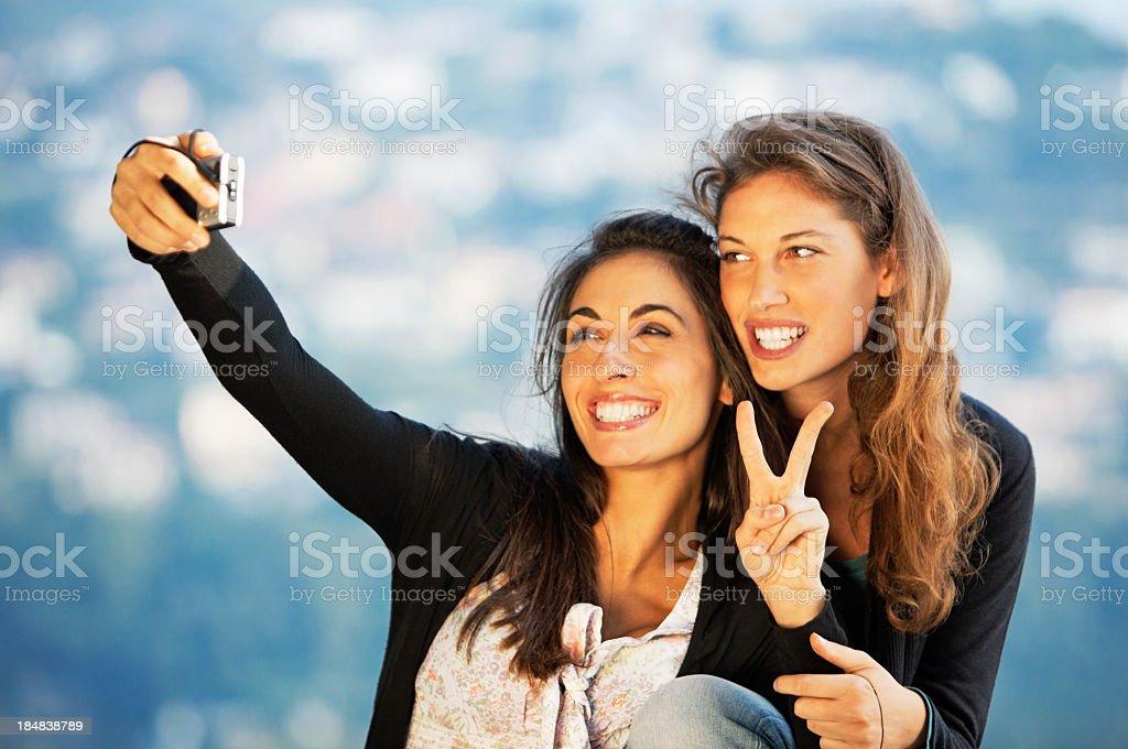 Happy Girls Using a Camera royalty-free stock photo