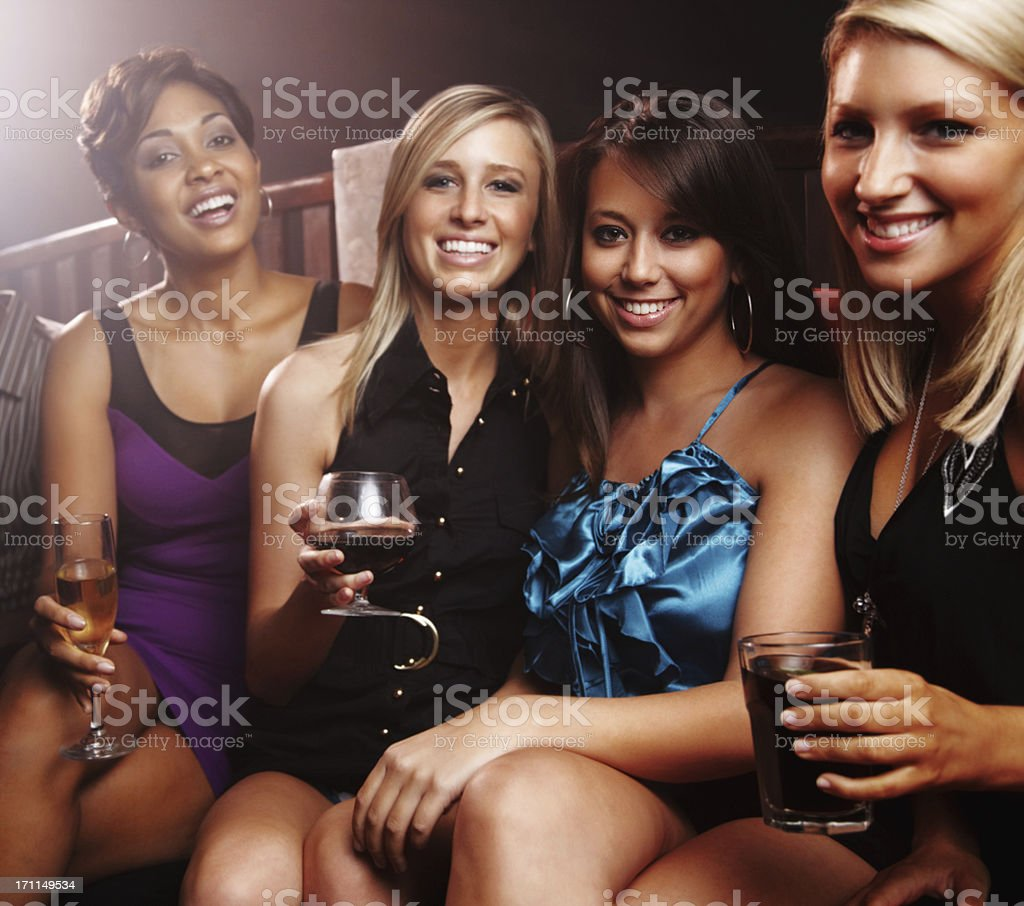 Happy girls with drinks enjoying a party royalty-free stock photo