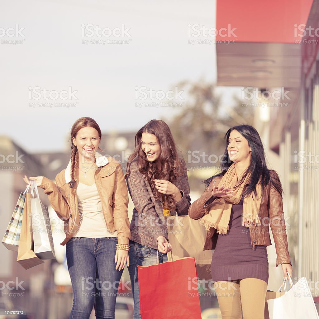 Happy girls with shopping bags royalty-free stock photo