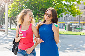 istock Happy girls with take away coffee outdoors 938542998