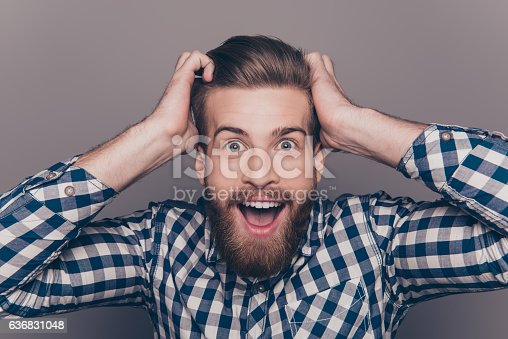 636829300 istock photo happy glad young man shoked with great news 636831048