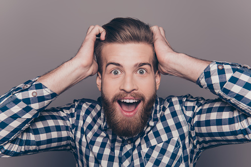 636829368 istock photo happy glad young man shoked with great news 636831048