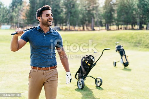 Golf player walking on the course