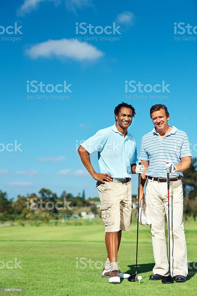 Happy golf player standing together on course royalty-free stock photo