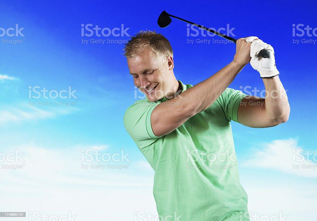Happy golfer swinging royalty-free stock photo