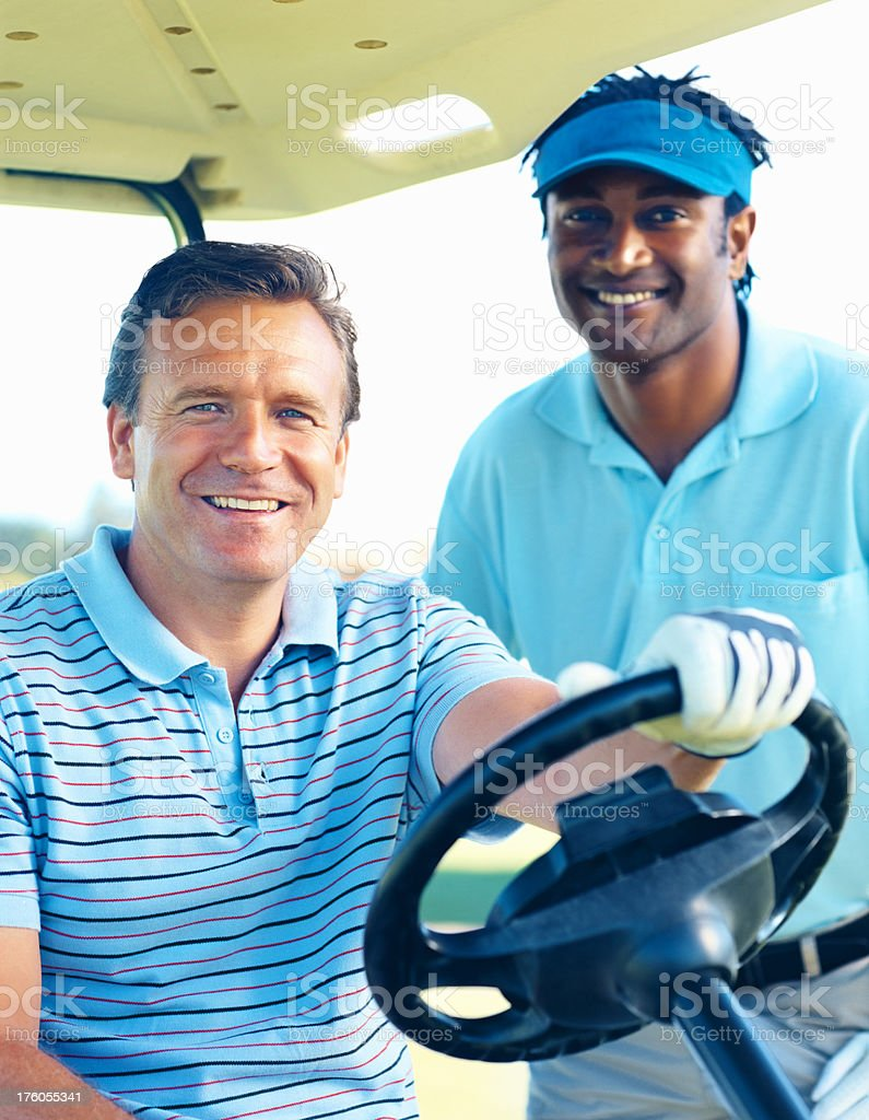 Happy golfers driving at the course royalty-free stock photo