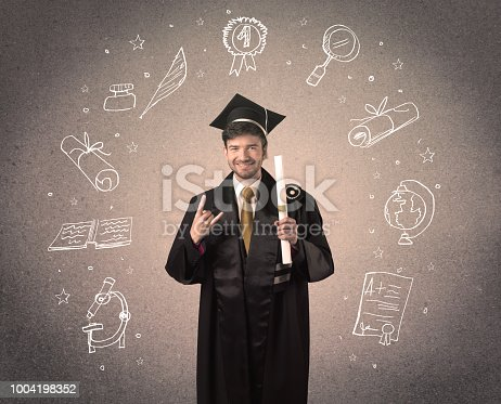 istock Happy graduate teenager with hand drawn school icons 1004198352