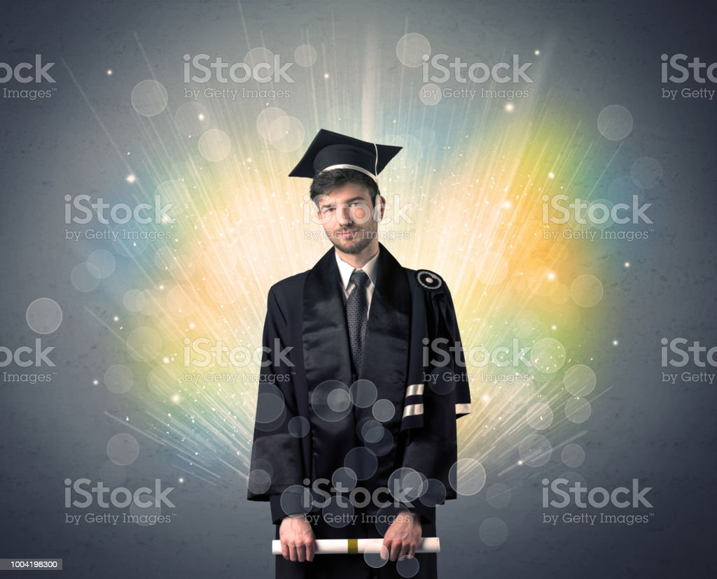 Happy graduate with colorful bokeg lights in the background stock photo