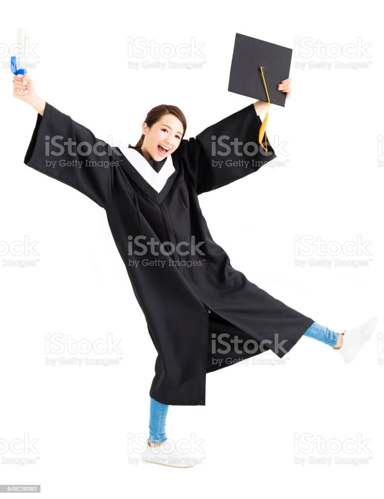 Happy graduation student dancing and showing diploma stock photo