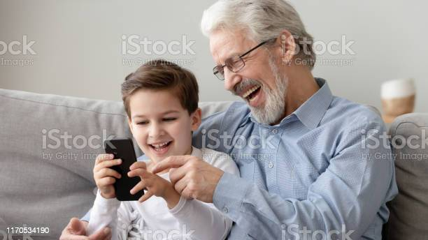 Happy grandfather and little grandson using phone have fun together picture id1170534190?b=1&k=6&m=1170534190&s=612x612&h=p1xzctuqjveb yod1s ukvreuaoenap3jqvjfxhkd4i=