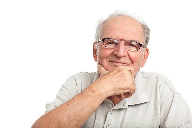 felice nonno su bianco. - mano sul mento foto e immagini stock