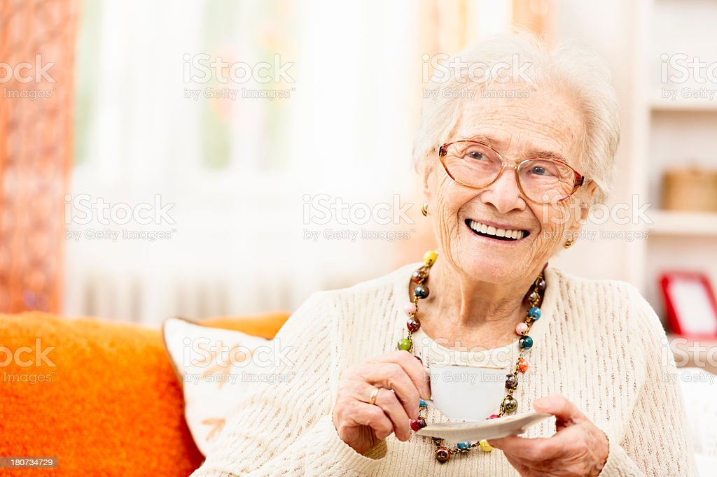Happy grandmother at home stock photo