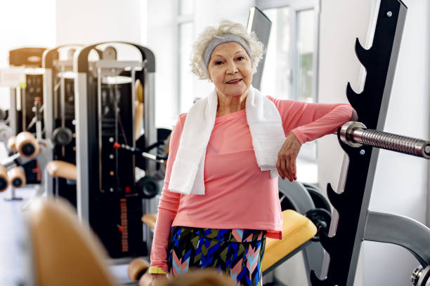 happy grandmother in fitness center - foto de stock