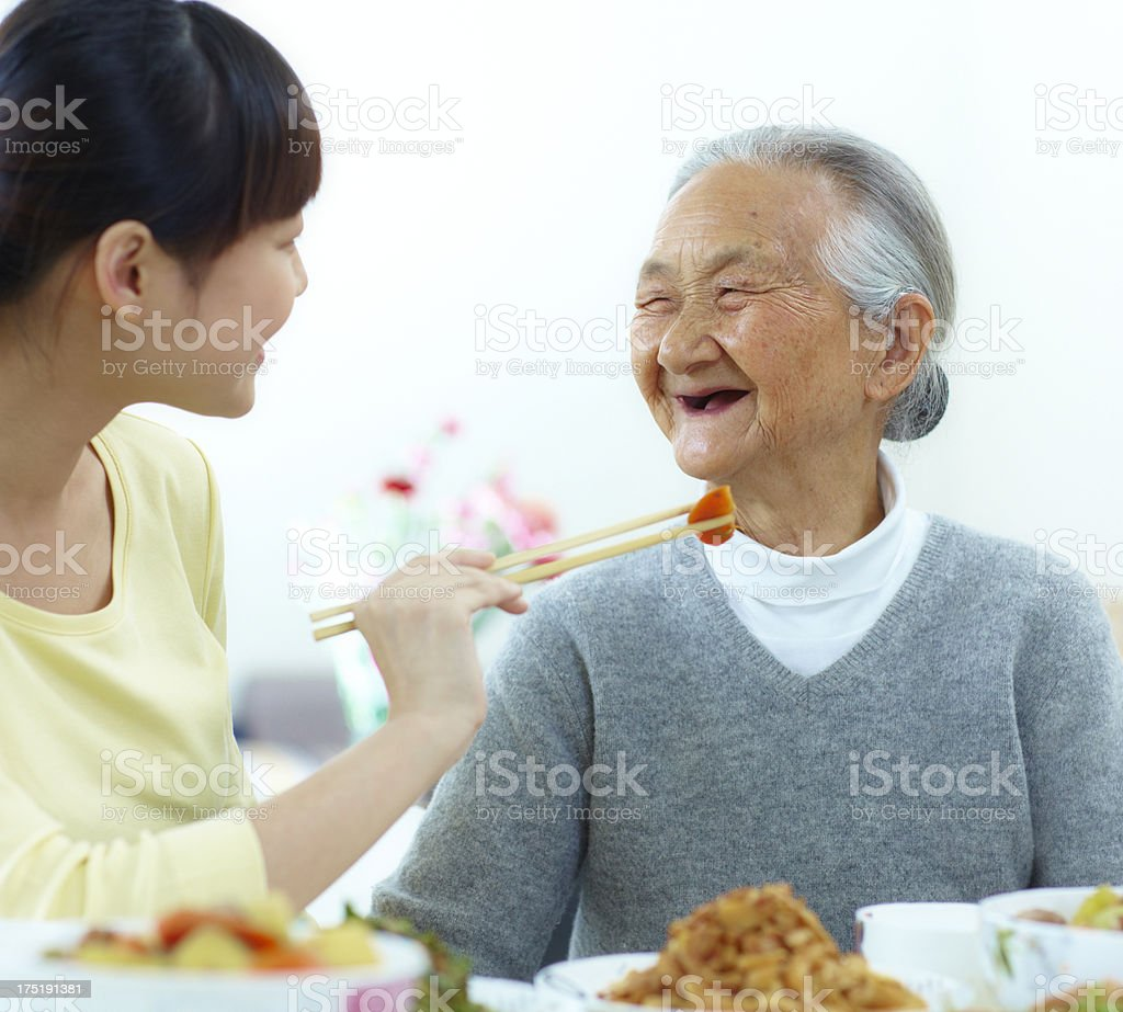 happy grandmother with her granddaughter have meal together royalty-free stock photo