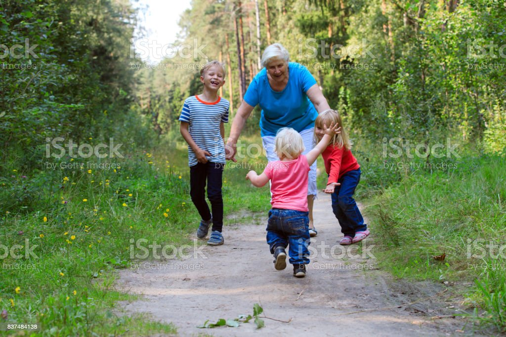 happy grandmother with kids play in nature royalty-free stock photo